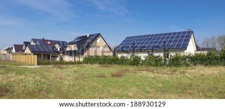 modern houses with solar panels on its roof - stock photo