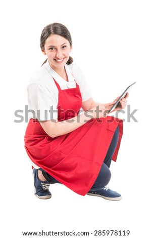 Modern hypermarket female worker using tablet and smiling friendly