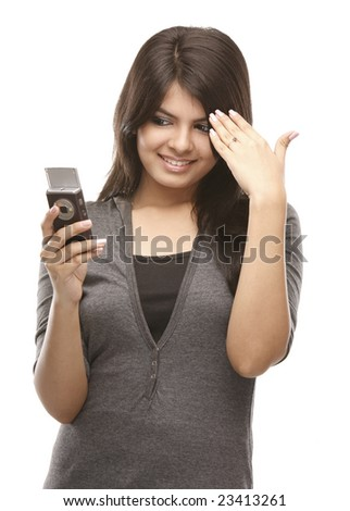 Modern indian teenage girl with cell phone - stock photo