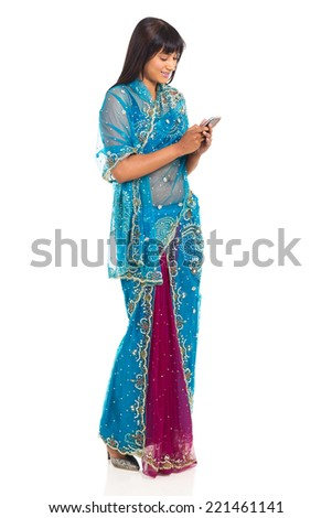 modern indian woman in sari using cell phone isolated on white - stock photo