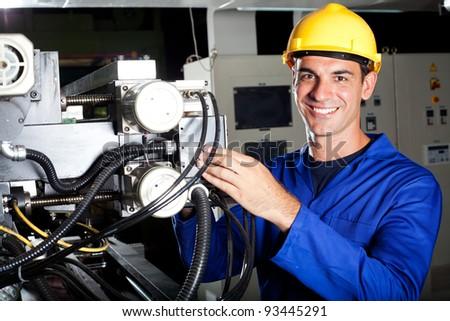 modern industrial machine operator at work - stock photo