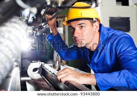 modern industrial machine operator working in factory - stock photo