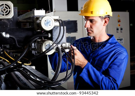 modern industrial machine operator working on machine