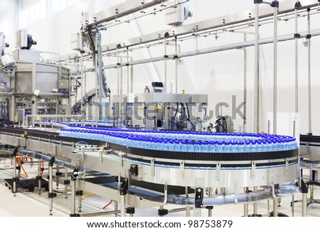 Modern industrial shop on pouring mineral water - stock photo