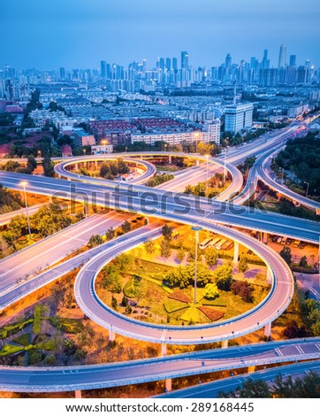 modern interchange road with city skyline in tianjin ,road transport background - stock photo