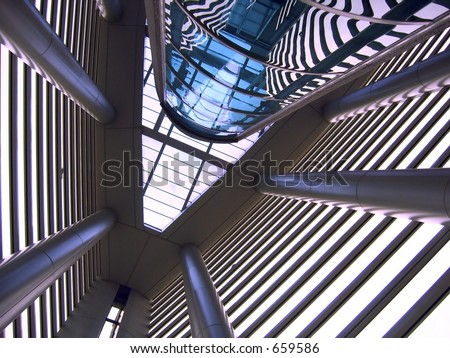 Modern Interior Architecture -- with an external elevator shaft