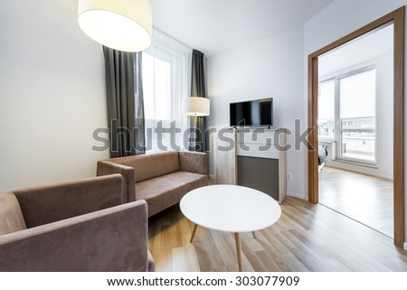 Modern interior design: wide view of living room in scandinavian style - stock photo