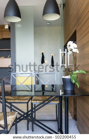 Modern interior design with table and bathroom - stock photo