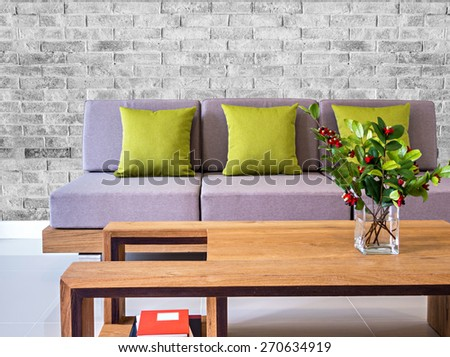 Modern interior Living room with sofa, flower vase and brick wall background - stock photo