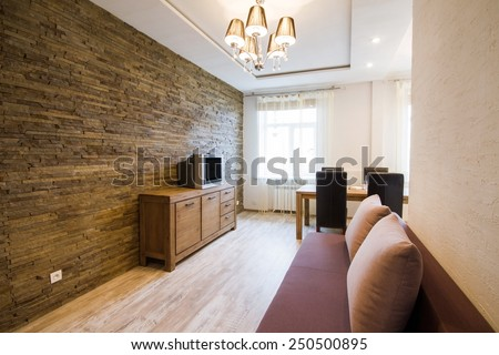 Modern interior of a living room studio. Kitchen with dinner table - stock photo