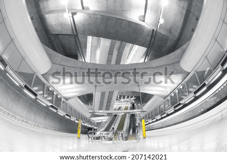 Modern interior of a subway station, blurred people