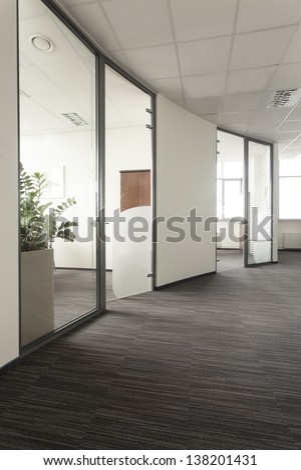 Modern interior of an office, glass door - stock photo