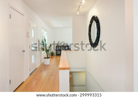 Modern interior of hallway at house with staircase.  - stock photo