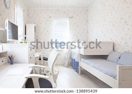 Modern interior of kid's bedroom in sunlight  - stock photo