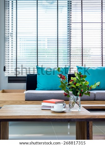 Modern interior of Living room still life with flower vase and sofa background - stock photo