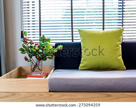 Modern interior of Living room with flower vase beside  part of sofa - stock photo