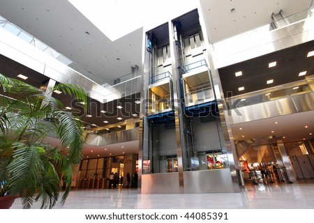 Modern interior of trade center with lifts - stock photo