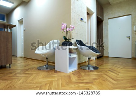 Modern interior with chair and table-waiting room - stock photo