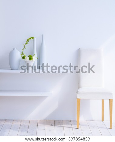 Modern interior with chair and vase