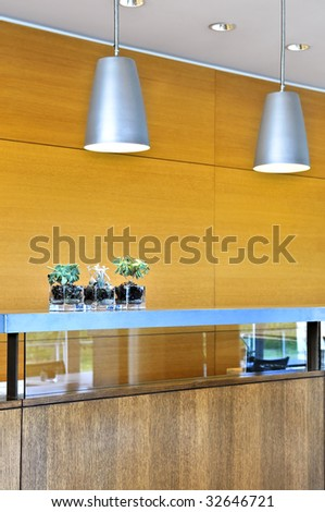 Modern interior with light fixtures and wood panels - stock photo