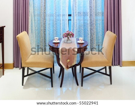 Modern interiors with coffee table and chairs - stock photo