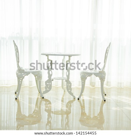 Modern interiors with white table and chairs - stock photo