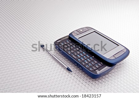 Modern internet capable cellphone with slide-out keyboard. - stock photo