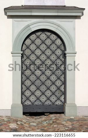 Modern iron door in a retro medieval style. Mass production - stock photo