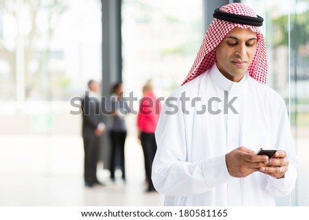 modern islamic businessman using smart phone - stock photo