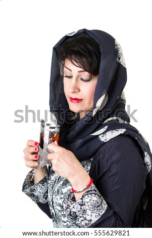 Modern islamic woman with cup of tea
