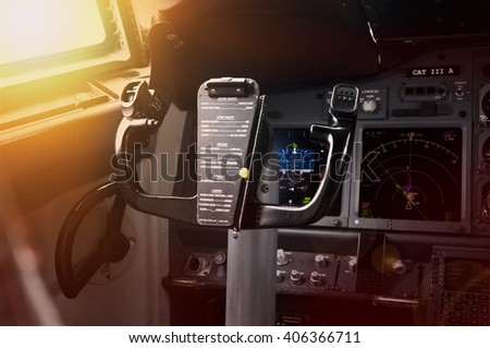 Modern jet airliner plane with glass cockpit at sunset - stock photo