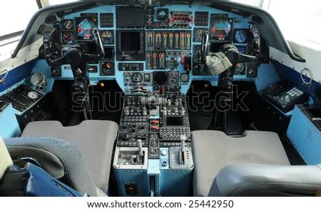 Modern jet airplane cockpit control view - stock photo