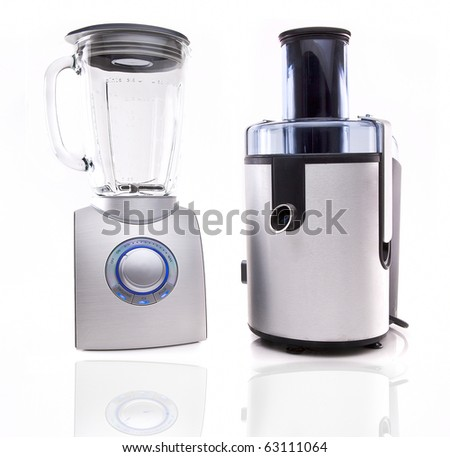 Modern juice extractor and Blender isolated on a white background. - stock photo