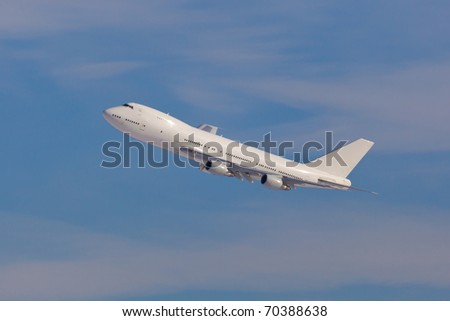 Modern jumbojet climbing after a take off - stock photo