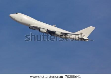 Modern jumbojet climbing after a take off - stock photo