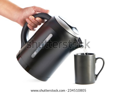 Modern kettle pouring water into a cup on a white background - stock photo