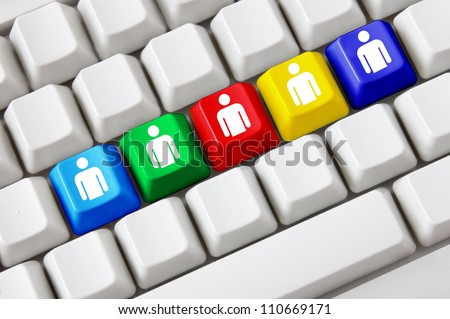 Modern keyboard with colored buttons and social media symbols - stock photo