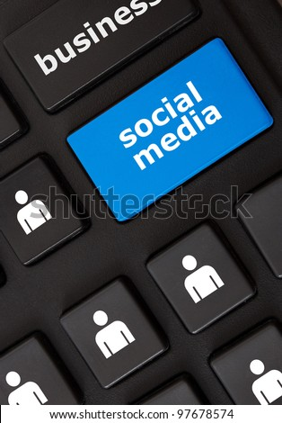 Modern keyboard with social media text and people symbols. Social network concept - stock photo