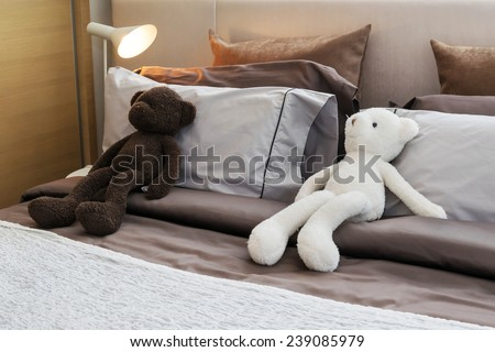 modern kids room with dolls and pillows on bed - stock photo