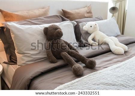 modern kids room with dolls and pillows on bed