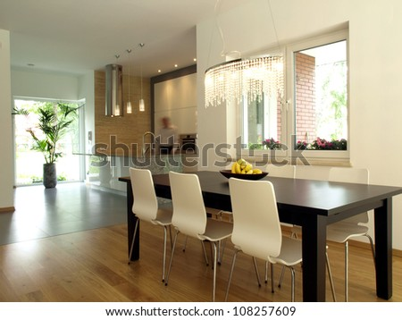Modern kitchen and a dining room in a contemporary house. - stock photo