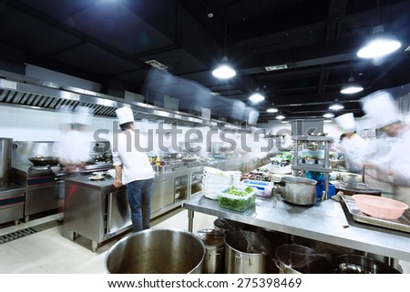 modern kitchen and busy chefs  - stock photo