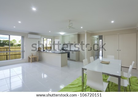 Modern kitchen and dining area in Australian townhouse