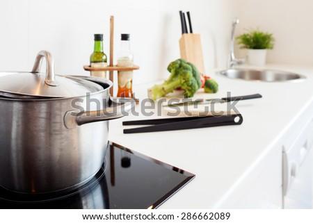 modern kitchen cooking - stock photo