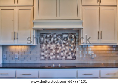 Modern Kitchen Counter And Cabinets With Granite Counters, White Cabinets,  Cook Top, Subway