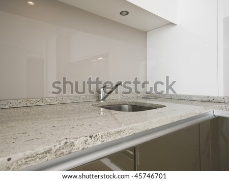 modern kitchen counter closeup with granite worktop - stock photo