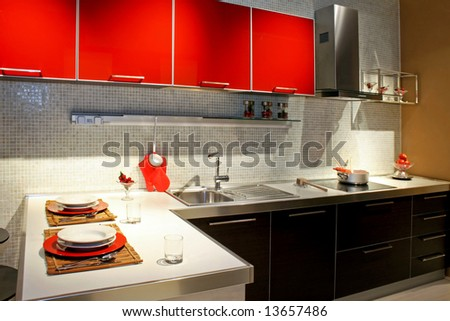 Modern kitchen counter with red details and lobster - stock photo