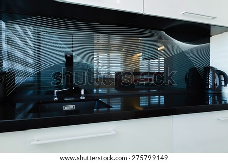 modern kitchen design in reg and white wall - stock photo