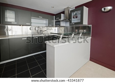 modern kitchen detail with stainless steel elements and breakfast bar - stock photo
