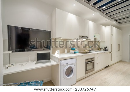 Modern kitchen, dining room in luxury house. - stock photo